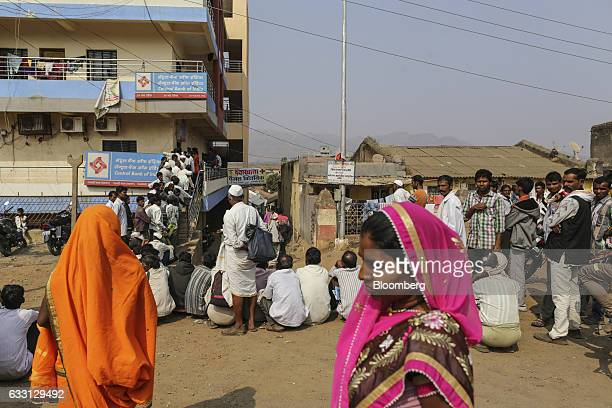 Customers wait in line to withdraw money from a Central Bank of India branch in Dhadgaon village Maharashtra India on Wednesday Jan 18 2017 The Feb 1...