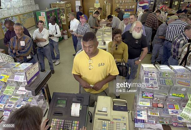 Customers wait on line to purchase tickets for the Big Game multistate lottery at Dad's Restaurant April 11 2002 in Lavonia GA The restaurant which...