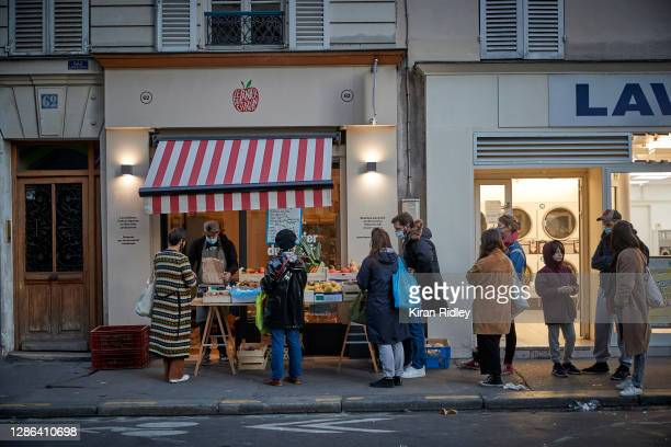 Customers wait to be served during Happy Hour at Panier du Citadin's shop in the 18th Arrondissement on November 18, 2020 in Paris, France. Sourcing...