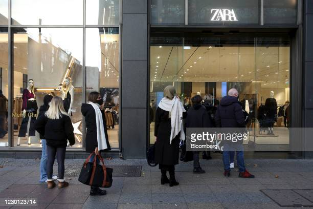Customers wait to enter a Zara clothing store, operated by Inditex SA, in Berlin, Germany, on Monday, Dec. 14, 2020. Germany will start a hard...