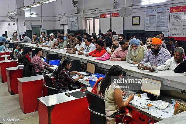 Customers wait to exchange Indian five hundred and one thousand rupee banknotes at an India Post branch in New Delhi India on Tuesday Nov 15 2016 The...