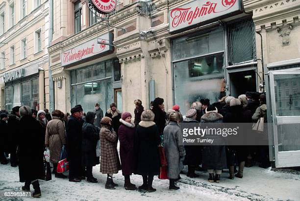 Customers wait to get into bakery