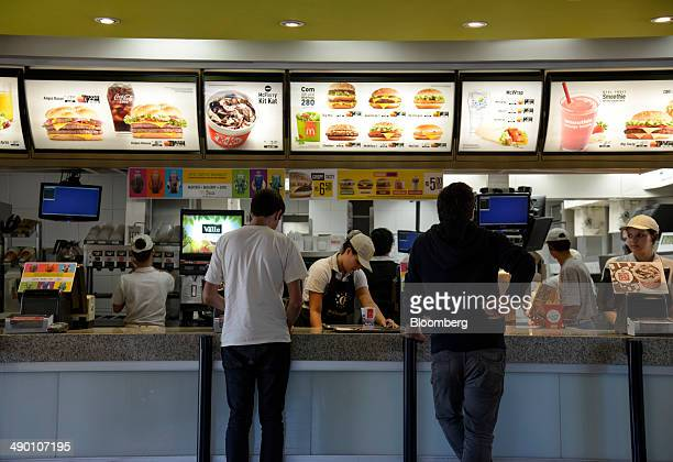 Customers wait to order at a McDonald's Corp restaurant in Barueri Brazil on Tuesday April 29 2014 After being sued by employees in Brazil who...