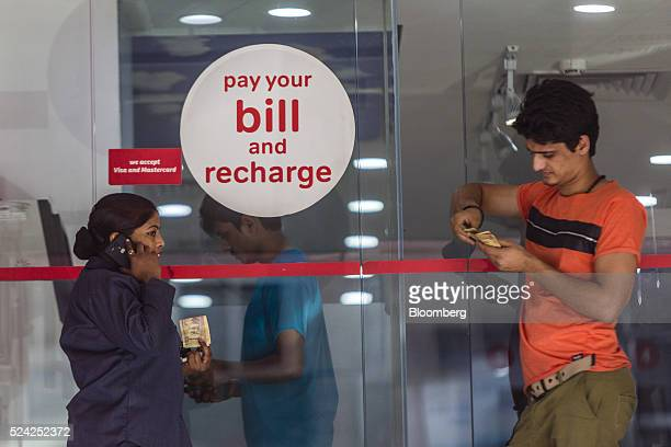 Customers wait to pay their bills at a Bharti Airtel Ltd store in New Delhi India on Sunday April 24 2016 Bharti India's largest mobilephone carrier...