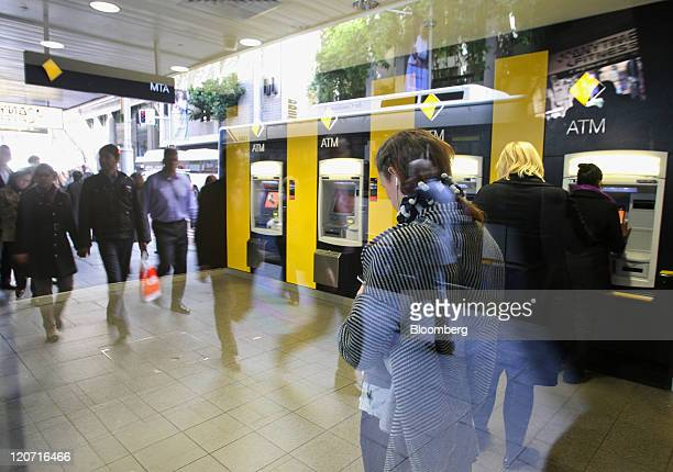 Customers wait to use Commonwealth Bank of Australia automated teller machines in Sydney Australia on Tuesday Aug 9 2011 Commonwealth Bank of...