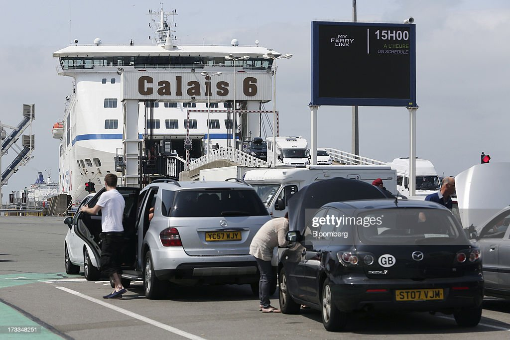 Customers wait with their vehicles before boarding the passenger ferry 'Berloiz', operated by MyFerryLink, a unit of Groupe Eurotunnel SA, at the Port of Calais in Calais, France, on Thursday, July 11, 2013. Eurotunnel was barred by the U.K. Competition Commission from operating a ferry service between France and Dover in the U.K. on concern it would give it too much dominance on the Channel traffic route. Photographer: Chris Ratcliffe/Bloomberg via Getty Images