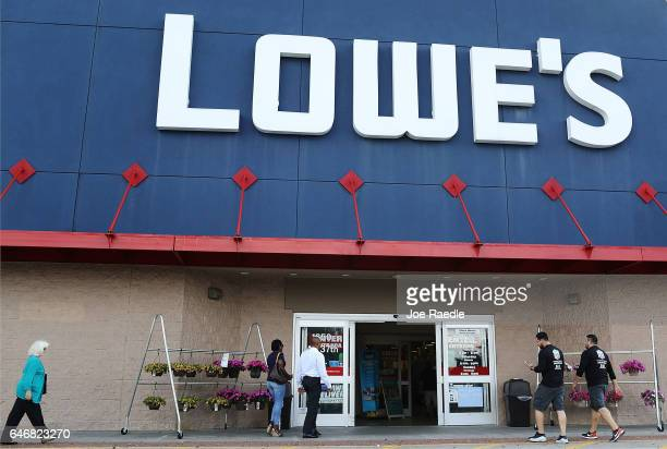 Customers walk into a Lowe's store on the day the company reported a rise in earnings on March 1 2017 in Hialeah Florida Lowe's reported...