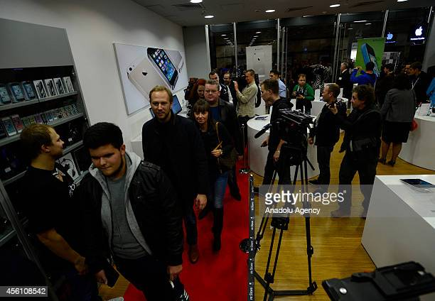 Customers walk into the reStore at Europeisky Shopping Mall in Moscow as iPhone 6 and iPhone 6 Plus retail sales begin in Russia on September 25 2014