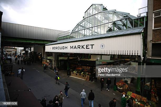 Customers walk near Borough Market on February 7 2013 in London England Borough Market London's oldest since 1756 has recently completed renovation...