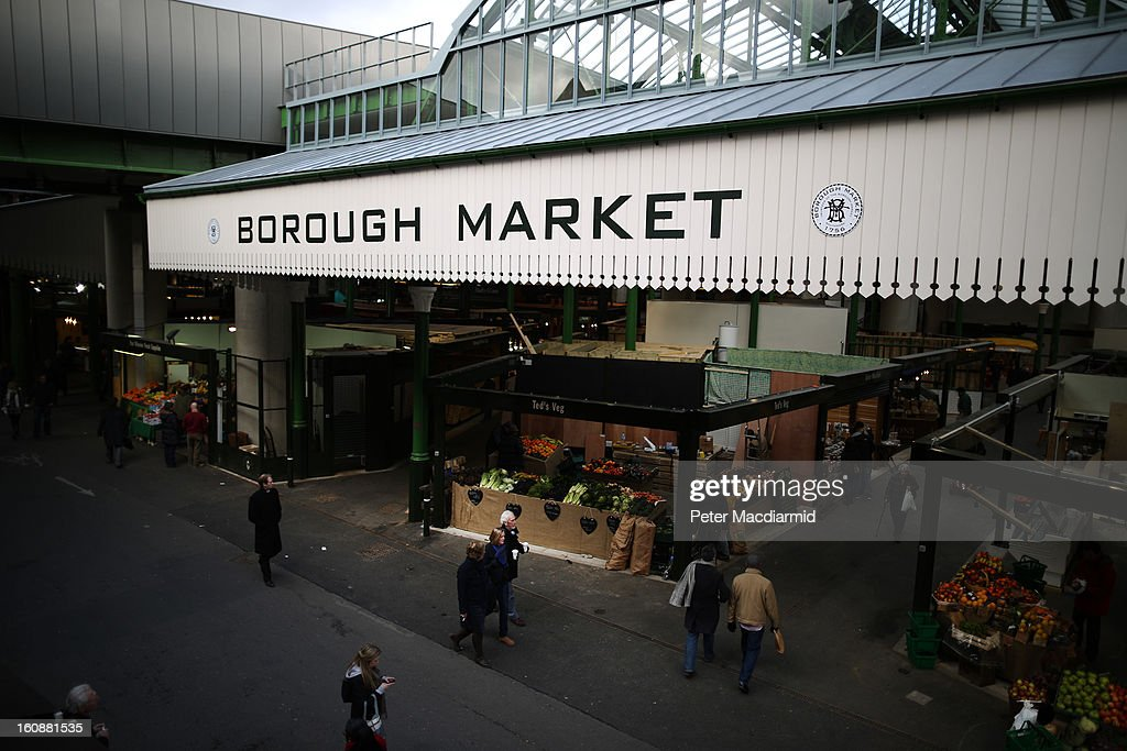 Customers walk near Borough Market on February 7, 2013 in London, England. Borough Market, London's oldest since 1756, has recently completed renovation and today had it's first day of full trading.