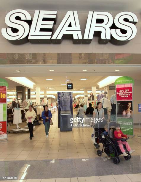 Customers walk out of a Sears store March 15 2006 in San Bruno California Sears Holdings Corp announced a higherthanexpected quarterly profit with...