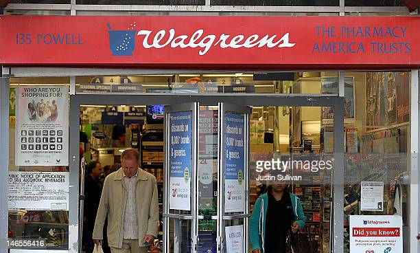 Customers walk out of a Walgreens store on June 19 2012 in San Francisco California US based drug store chain Walgreens has announced a deal to...