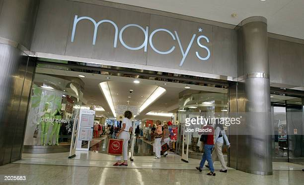 Customers walk out of Macy's the day after the company announced that the 56 Burdines stores and the seven Macy's stores in Florida all will operate...