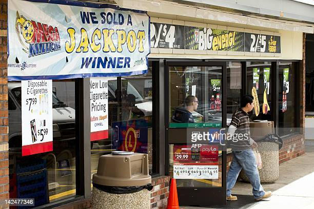Customers walk out of the 7Eleven April 5 where the winning Mega Millions jackpot ticket was sold in Baltimore MD The Maryland winner of the 105...