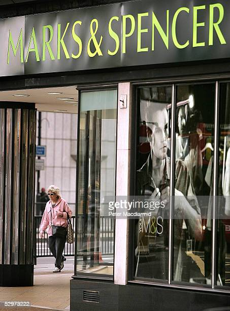 Customers walk past a Marks and Spencer store on Edgeware Road on May 24 2005 in London Retail icon Marks and Spencer has posted pretax profits of...
