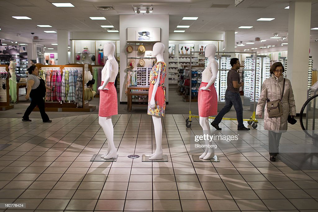 Customers walk past mannequins displayed at a J.C. Penney Co. store in the Queens borough of New York, U.S., on Tuesday, Feb. 26, 2013. Confidence among U.S. consumers jumped more than forecast in February as Americans adjusted to a higher payroll tax and signs of a recovering housing market spurred faith in the future. J.C. Penney Co. is scheduled to release earnings data on Feb. 27. Photographer: Victor J. Blue/Bloomberg via Getty Images