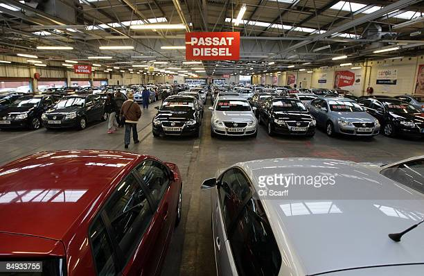 Customers walk past some of the thousands of cars on sale at Cargiant the world's largest car supermarket in White City on February 18 2009 in London...