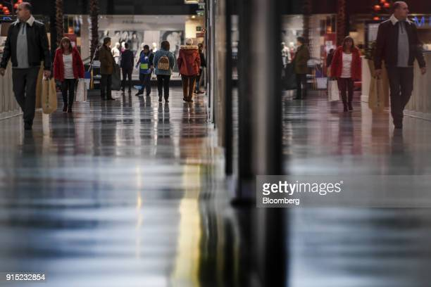Customers walk through a shopping arcade at the Dolce Vita Tejo shopping mall operated by AXA Real Estate Investment Managers SGR SpA in Lisbon...