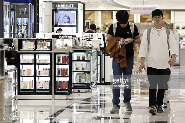 Customers walk through the cosmetics section of the Lotte Duty Free Shop in the Tokyu Plaza Ginza shopping complex in the Ginza district of Tokyo...