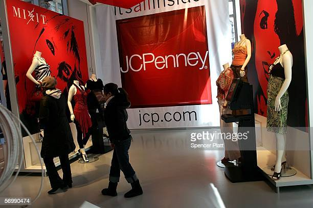 Customers walk through the new JC Penney 15000square foot temporary promotional store or popup store in Times Square March 3 2006 in New York City...
