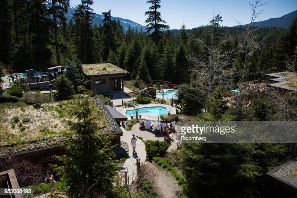 Customers walk through the Scandinave Spa in Whistler British Columbia Canada on Friday April 27 2018 The cost of a typical home in Whistler has more...