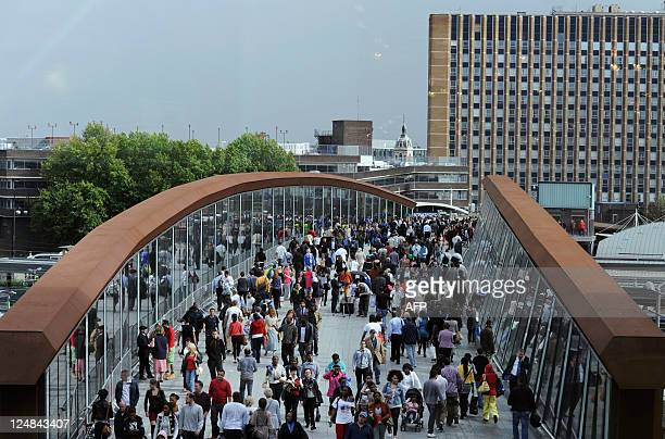 Customers walk to and from the newly opened Westfield Stratford City shopping centre in east London on September 13 2011 Europe's biggest urban...