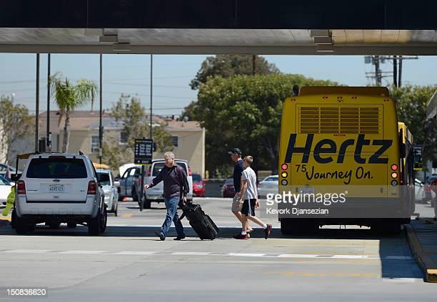Customers walk to their cars at Hertz Global Holdings car rental Los Angeles International Airport branch August 27 2012 in Los Angeles California...