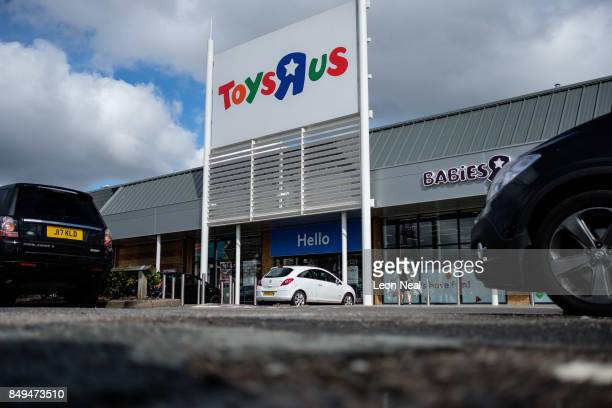 Customers walk towards a branch of the toy store Toys R Us on September 19 2017 in Luton England The company has struggled to compete against online...