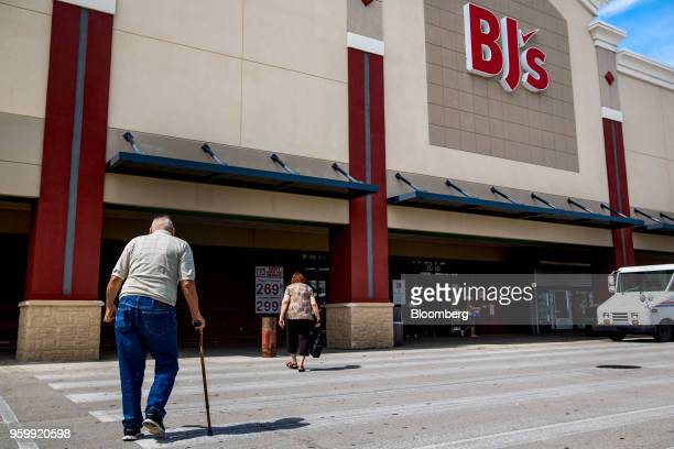 Customers walk towards the entrance of a BJ's Wholesale Club Holdings Inc location in Miami Florida US on Friday May 18 2018 The warehouseclub chain...