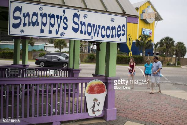 Customers walk towards the Snappy's Snowcones store in Gulf Shores Alabama US on Tuesday June 27 2017 Bloomberg is scheduled to release consumer...