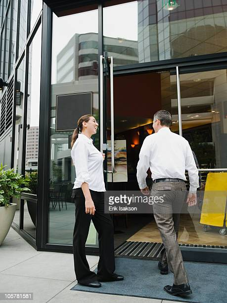 Customers walking into building