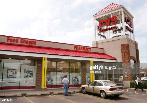 Customers walks towards the entrance of a CVS drugstore July 30 2003 in Chicago CVS reported a second quarter profit increase of 13 percent