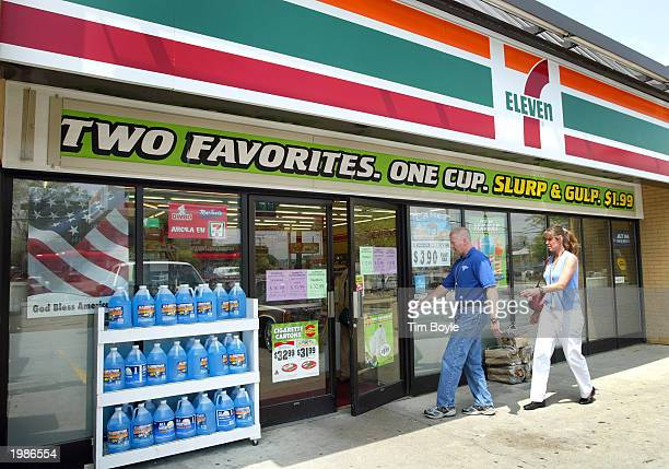 Customers walks towards the entrance to a 7Eleven store May 9 2003 in Des Plaines Illinois Dallas Texasbased 7Eleven Inc the world's largest...