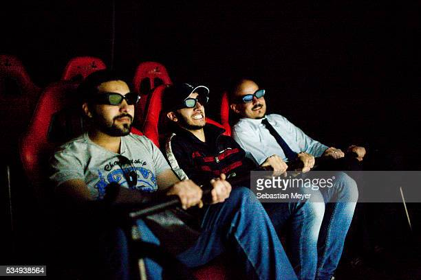 Customers watch a 3D movie in the new Maximall in the wealthy Mansour district of Baghdad 10 years after the US led invasion Iraq continues to suffer...
