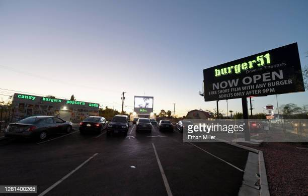 Customers watch a short film at the newly opened Area 51-themed Burger51 drive-thru hamburger stand and drive-in movie theater on July 27, 2020 in...