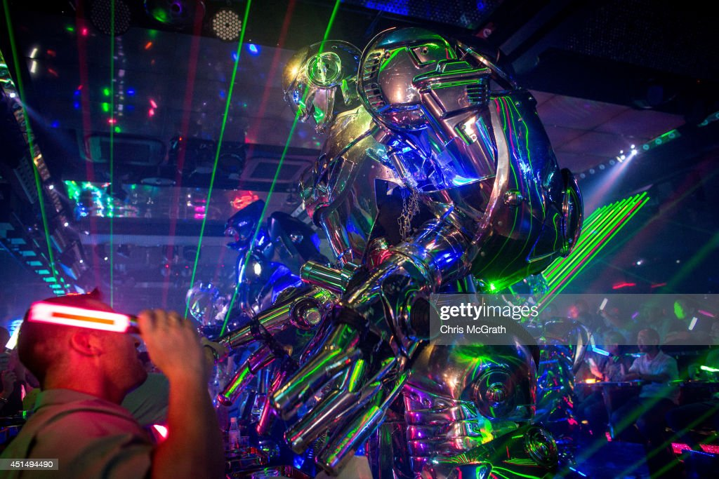 Customers watch on as a large scale robot performs during a show at The Robot Restaurant on June 29, 2014 in Tokyo, Japan. The now famous Robot Restaurant opened two years ago in Kabukicho area of Shinjuku at an estimated cost of 10 million U.S. dollars. Performances are held three times a day and cater mostly to foreign tourists. The cabaret style shows include bikini clad futuristic dancers, performers dressed as robots and a host of large scale robots and vehicles controlled with remotes by stage hands dressed as Ninjas