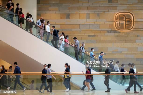 Customers wearing face masks use escalators at a shopping mall on September 4 2020 in Hong Kong China