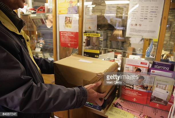 Customers weigh packages inside the historic Lacock Village Stores and Post Office on December 15 2008 in Lacock United Kingdom Post Offices across...