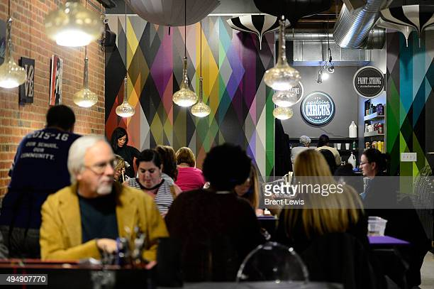 Customers work on crafts in the projects space October 29 2015 at Upstairs Circus The workshop has a menu full of crafts and drinks for guests to...