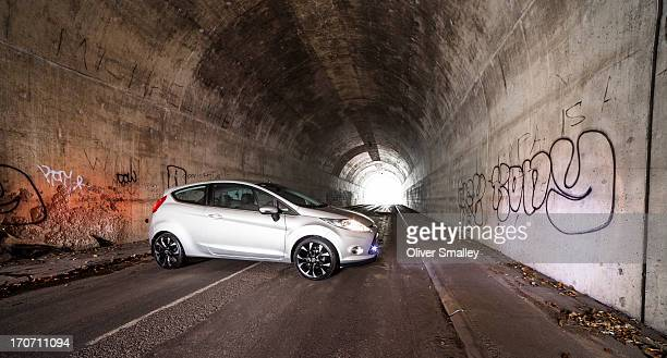 CONTENT] A customised Ford Fiesta sits in a dark tunnel underneath the wellknown M25 Motorway that circles around London England This image was taken...