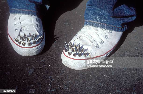 Customised pair of Converse trainers with metal spikes on the toes by fashion designer Tom Clulee London 2004