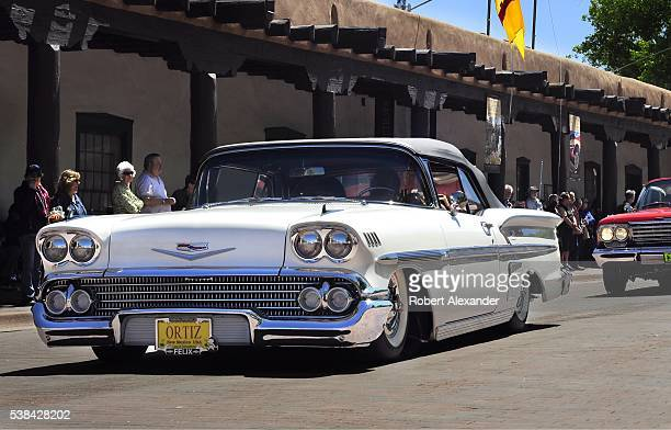 A customized 1958 Chevrolet Impala lowrider parades through Santa Fe New Mexico on May 22 2016