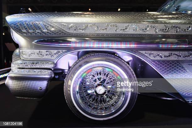 A customized 1958 General Motors Co Chevrolet Impala vehicle decorated with diamond engraving stands on display at the Tokyo Auto Salon in Chiba...
