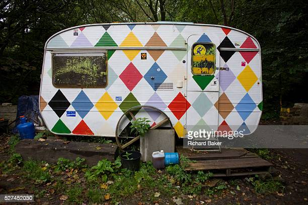 A customized caravan sits in the damp woods at the Faslane Peace Camp Argyll and Bute Scotland Matt Bury is one of the camp's 10 full time residents...