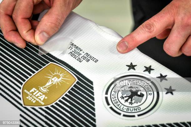 A customized home jersey of Germany for the world cup match of Germany against Mexico is seen during a visit of the Adidas production site on June 13...