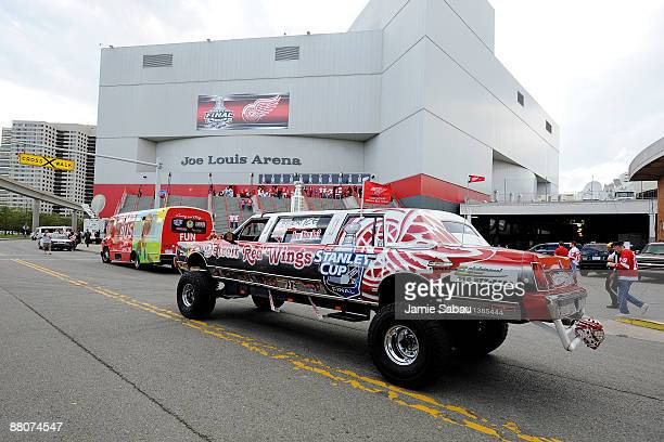 A customized limo painted in Detroit Red Wings colors drives past Joe Louis Arena before Game 1 of the 2009 Stanley Cup Finals on May 30 2009 in...