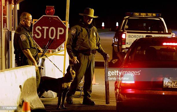 Customs and Border Patrol agents prepare to question a motorist at a checkpoint along Highway 94 outside of October 17, 2007 in Campo, California....