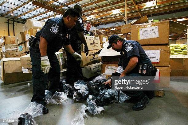 US Customs and Border Patrol officials from the AntiTerrorism Contraband Enforcement Team inspect a box of imported Israeli gas masks at a US Customs...