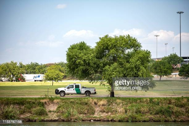 A Customs and Border Patrol truck drives through a local golf course in Eagle Pass Texas on July 4 2019 The Eagle Pass area of the border had seen an...