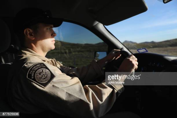 Customs and Border Protection agent drives along Interstate 10 on November 22 2017 in Van Horn Texas Federal agents are searching for suspects in the...